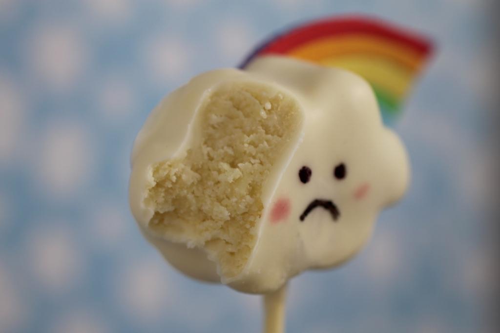 sad rainbow cloud face cake pop